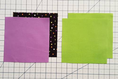Step 1 3 patch quarter square triangles: cut squares according to math chart.
