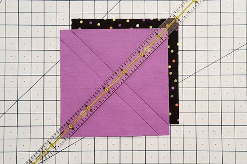 Step 1a 3 patch quarter square triangles: Mark Top Square Place one Fabric A square right side up and place one Fabric B square right side down on top of it.