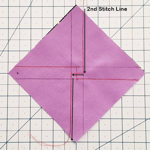 Step 2b 3 patch quarter square triangles:  repeat Step 2a above to make the second stitching line. It should intersect with the first stitching line near the middle of the block.