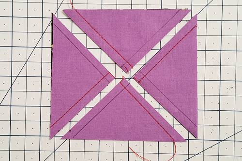 Step 3a 3 patch quarter square triangles:  Cut the square in half again by cutting it diagonally from the other corner to corner.