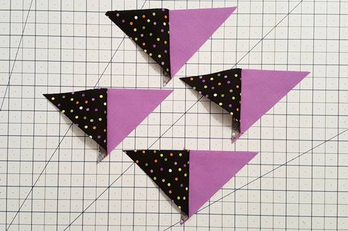 Step 3b 3 patch quarter square triangles:  Open the quarters so the fabric is right side up. You now have four half quarter square triangles. You've made Patches 1 and 2, the small triangles.