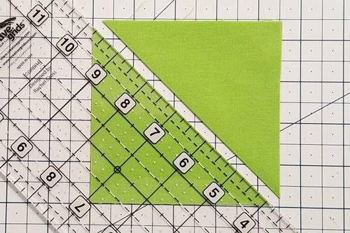 Step 4 3 patch quarter square triangles:  Make Patch 3. Cut the two Fabric C squares in half diagonally.
