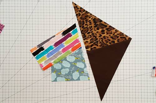 Step 5 Crazy Quilt Block: Select another scrap long enough to go beyond the edge of the side you just cut straight.