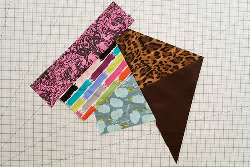 Step 7 Crazy Quilt Block: Repeat steps 2 to 4 to continue adding fabric pieces to the main unit.