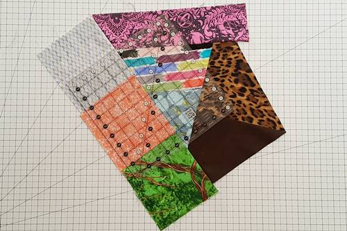 Step 11b Crazy Quilt Block: Position the ruler so that its edges extend at least one half to three-quarter inches beyond any seam.