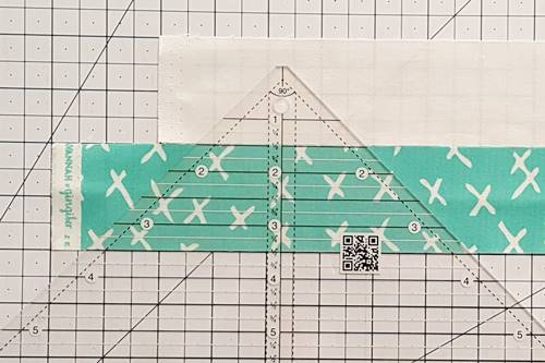 Step 1 Double Hourglass Quilt Block: Make Strip Set.