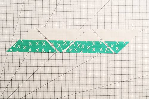 Step 4 Double Hourglass Quilt Block: Continue to rotate the ruler 180 degrees and cut QSTs until you have cut all of the QSTs that the strip set will allow.