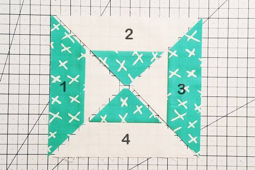 Step 5 Double Hourglass Quilt Block: Arrange 4 quarter square triangles into a block.