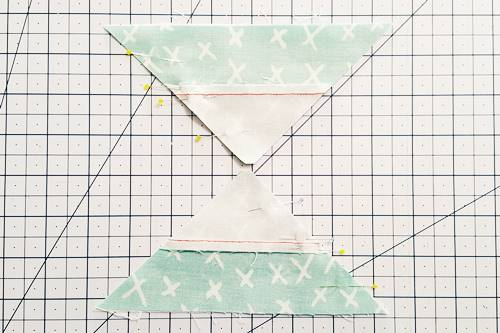 Step 6a Double Hourglass Quilt Block: Pair QST Number 3, right sides together, with QST Number 4. Pair QST Number 1, right sides together, with QST Number 2. Pin, nesting the seams.