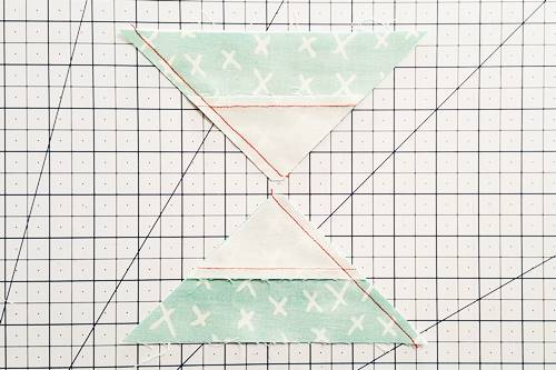 Step 6b Double Hourglass Quilt Block: With the blunt tip going under the needle first, stitch a 1/4 inch seam.