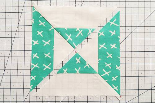 Step 7 Double Hourglass Quilt Block: Press the seams of each half in opposite directions.