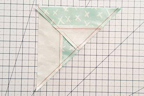 Step 8 Double Hourglass Quilt Block: With right sides together align the two halves along their long diagonal edge, nesting the three seams. Stitch a 1/4 inch seam.