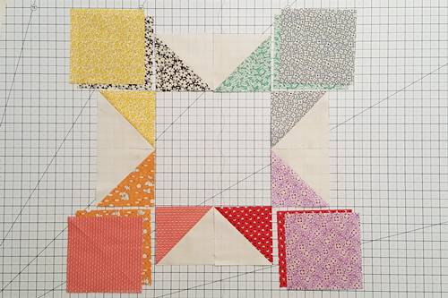 Step 6 Eight Point Star Quilt Block: Arrange one half square triangle of each color into star points.