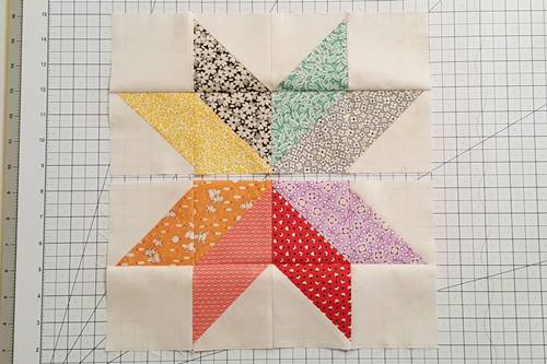 Step 11a Eight Point Star Quilt Block: Right sides together stitch Row 1 to Row 2, first matching center seam and nesting outer seams. Repeat to stitch Row 4 to Row 3. Flip Rows 1 and 4 right side up.