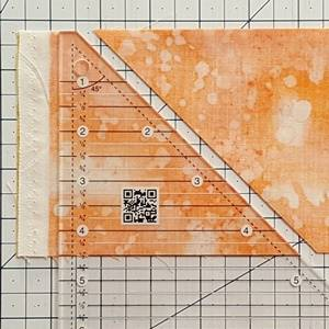 Step 1 Half Square Triangle Ruler: cut the fabric strips along the 45 degree angle side of the HST ruler.