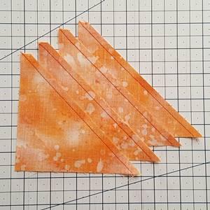 Step 6 Half square triangle ruler: stitch each HST with a 1/4 inch seam.