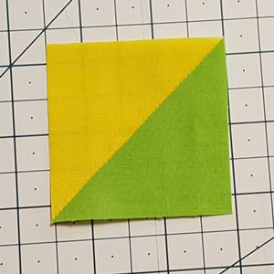 Half square triangle trimmed to size