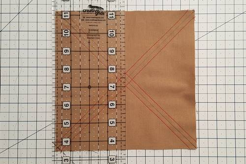 Step 3 Place a quilting ruler through the vertical center of the squares and make a cut through the center of the squares.