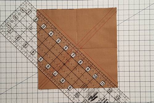 Step 5 Now cut the four squares into half square triangles along both diagonal lines.