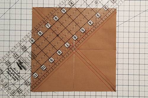 Step 6 Place the ruler diagonally from the other corners on the drawn line. Make a cut with the rotary cutter.