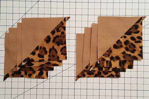 Step 7 Open the half square triangles and press the seams towards the darker fabric.