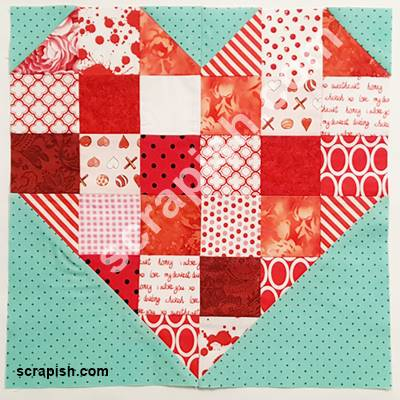 Picture of a scrappy heart quilt block pattern.