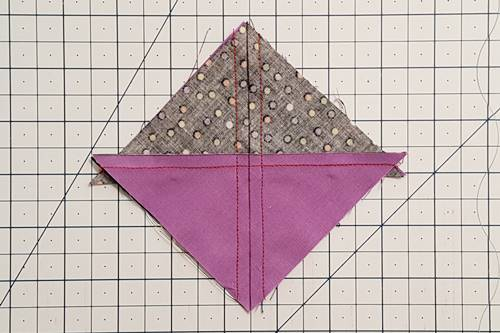 Step 3 Hourglass Quilt Block: Stitch a 1/4 inch seam away from both sides of the marked line.