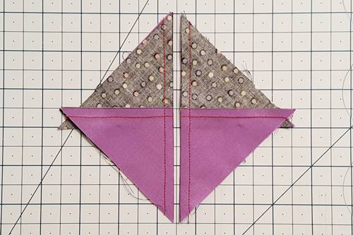 Step 4 Hourglass Quilt Block: cut the squares apart on the marked diagonal line.