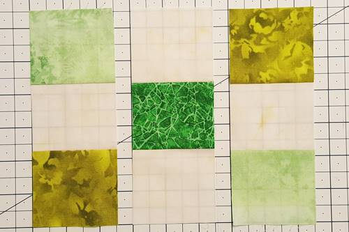 Step 4a Irish Chain Quilt Block: Arrange the units to make the block.