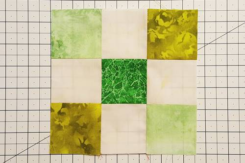 Step 4e Irish Chain Quilt Block: open units to right sides up.