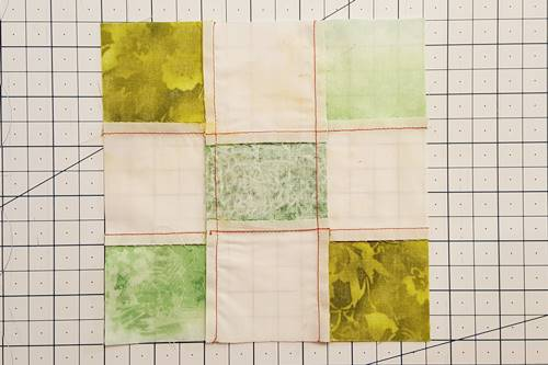 Step 5 Irish Chain Quilt Block: Press the seams outwards, away from the center unit.