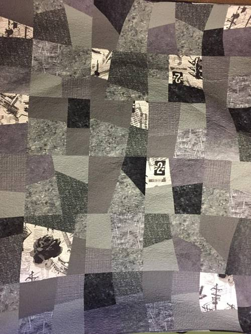 Free-form four patch quilt pattern