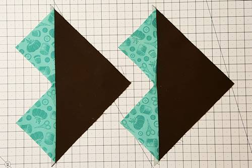 Step 5 No Waste Flying Geese: Flip the small triangles right side up and press the seams toward the small triangles.