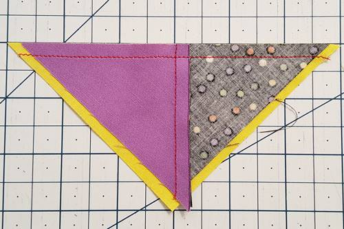 Step 4 With right sides together, pair one of the quarter square triangle halves with one of the half square triangle halves.