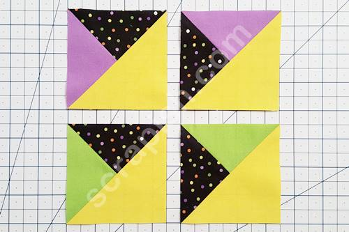 A picture of two sets of mirror image quarter square triangles.