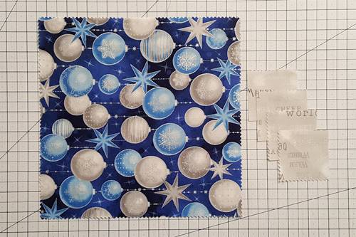 Step 1 Snowball Quilt Block: Cut 2 1/2 inch squares.