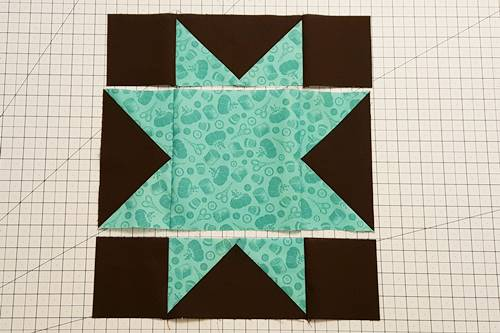 Step 4a Stitch units of Row 2 together of this star quilt block pattern.
