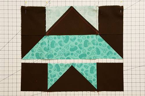 Step 7 Now sew Row 1 to Row 2 with right sides together. The bottom of Row 1 should be sewn to the top of Row 2 of this star quilt block pattern.