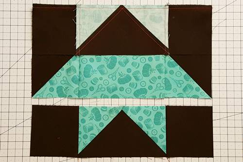 Step 7b Stitch Rows 1 and 2 together using a 1/4 inch seam. Press the seam toward the flying geese unit of this star quilt block pattern.