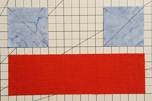 stitch and flip squares and rectangle to make boat shape Step 1