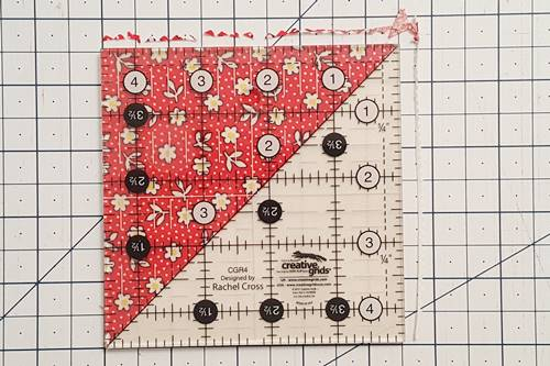 Step 2b half square triangle quilt pattern: Finish trimming half square triangles.