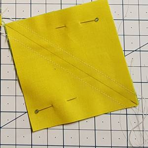 Half square triangle with seams