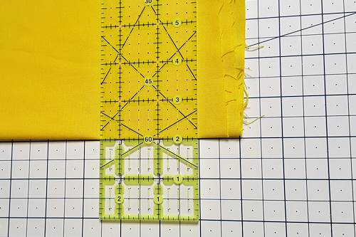 Step 3 Close-up: Fold aligned with horizontal measurement line on cutting mat. Ruler aligned along fold.