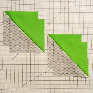 Step 1 Pinwheel Quilt Block Pattern: Make 4 half square triangles.