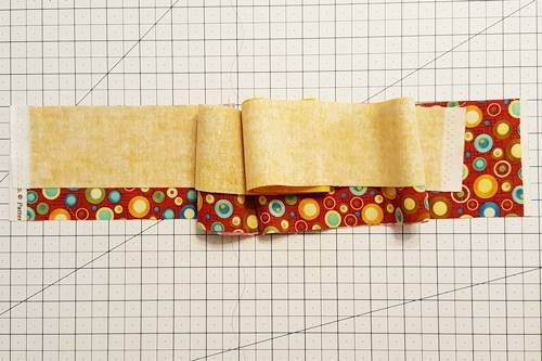 Step 2a Strip quilting: Sew the strips together in pairs.