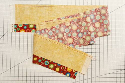 Step 2c Strip quilting: Your top selvage edges should be aligned.