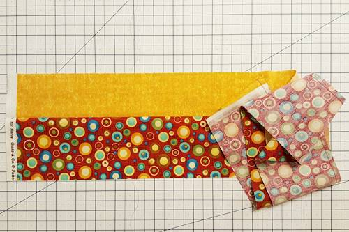 Step 2d Strip quilting: Open the strip set so that the right side of both fabrics face up.