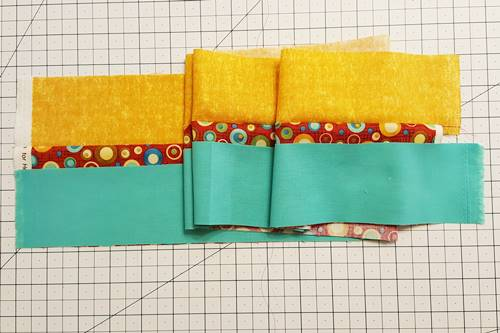 Step 2e Strip quilting: With right sides together, place Fabric C strip on top of Fabric B.