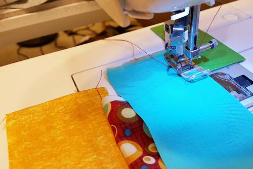 Step 2f Strip quilting: Sew the strips together using a 1/4 inch seam along the right side of the strips.