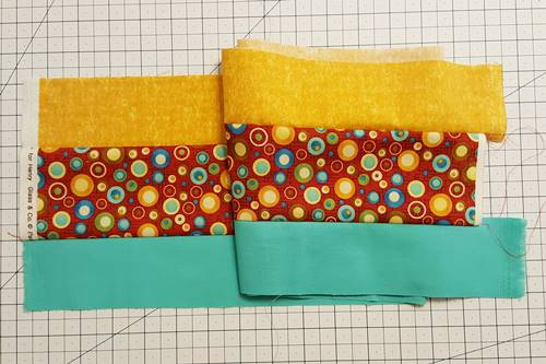 An example of strip quilting: a strip set made of 3 strips of fabric.